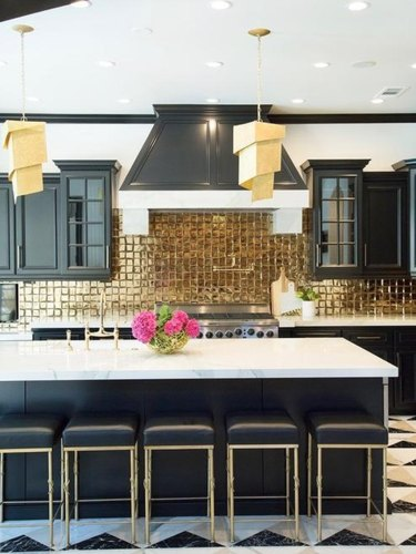 black and white kitchen with gold