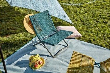 folding chair on picnic blanket