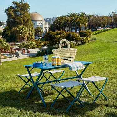 outdoor dining table with picnic supplies