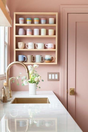 pink kitchen with pink door