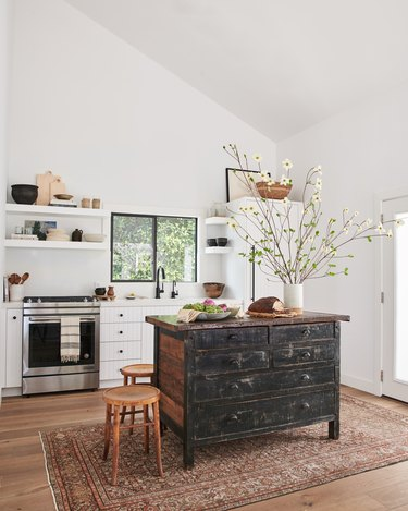 white kitchen with distressed freestanding island