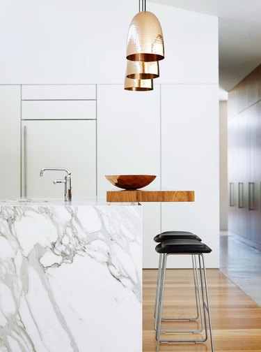 two-tier kitchen island with marble and wood