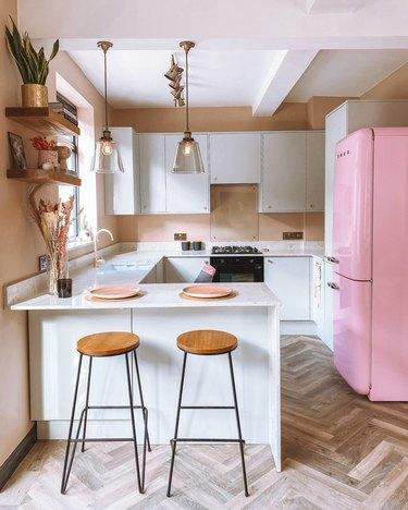 pink kitchen with retro pink refrigerator