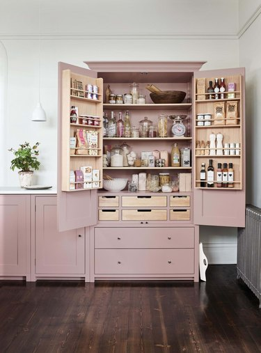 kitchen with pink cabinetsand white countertop