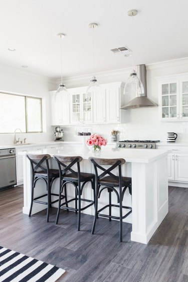 white industrial farmhouse kitchen with stainless steel finishes