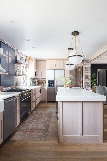 exposed brick wall in industrial farmhouse kitchen
