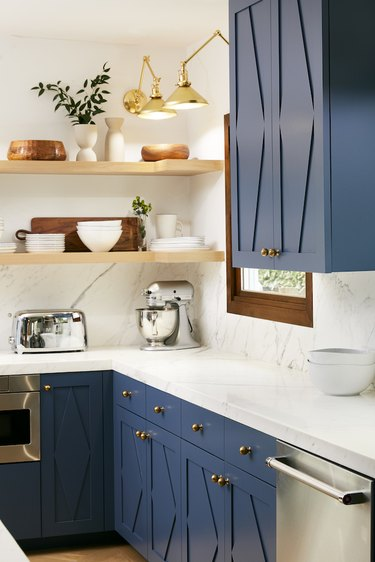 navy blue and white l-shaped kitchen with open shelving