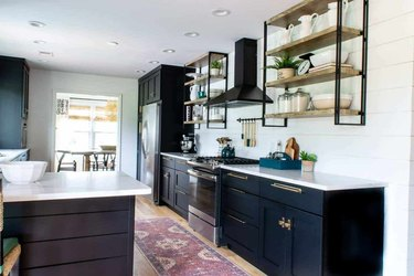 black industrial farmhouse kitchen with open shelving
