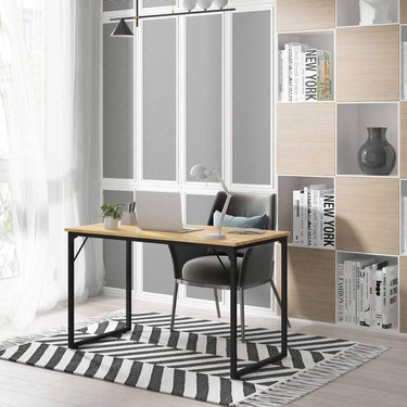 Wooden and metal desk in office