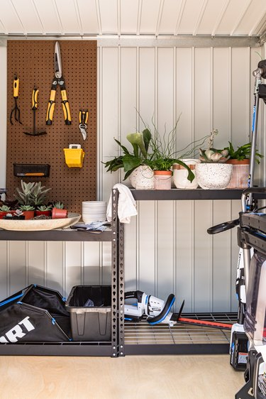 outdoor shed with tools and plants