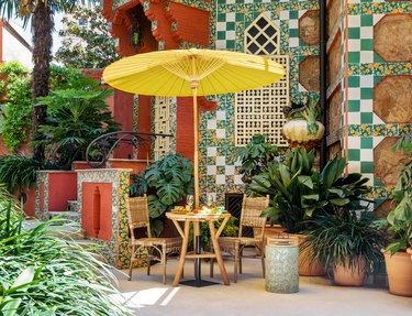 outdoor seating area with yellow umbrella in Casa Vicens