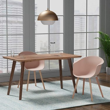 Nude pink chairs with dining table