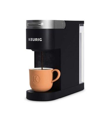 Black coffee maker with mug