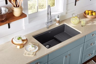 Composite undermount sink in charcoal.