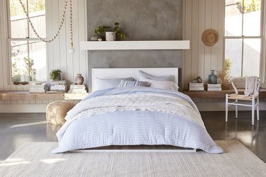 bedroom with blue and white bedding