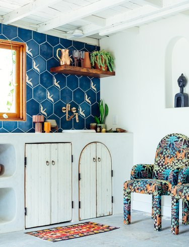 white and blue bohemian kitchen with blue patterned backsplash
