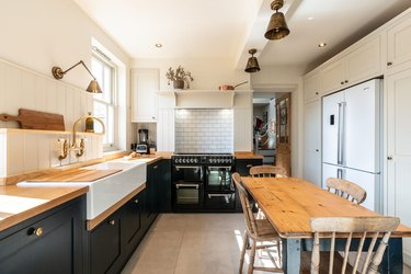 black and wood l-shaped kitchen with dining table