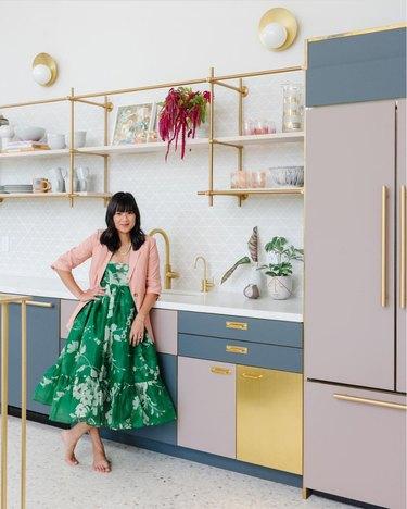 Joy Cho of Oh Joy! standing in kitchen