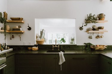 white and green bohemian kitchen with open shelves