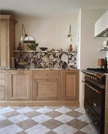 bold marble backsplash in wood and white kitchen