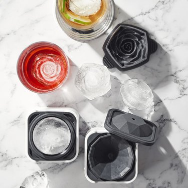 overhead photo of glasses and molds for flower-shaped ice cubes
