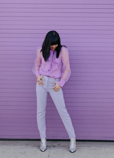 Joy Cho of Oh Joy! standing in front of purple wall