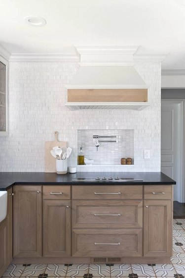traditional kitchen with wood cabinets and white tile backsplash