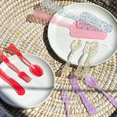overhead photo of dishes and utensils in various colors