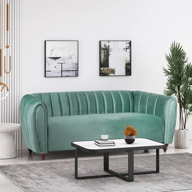 Turquoise glam sofa in a living room