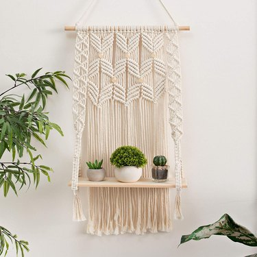macrame wall hanging with integrated floating shelf