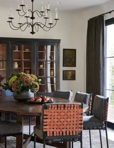 california style rustic dining room with leather woven chairs