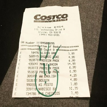 costco receipt with smiley face doodle