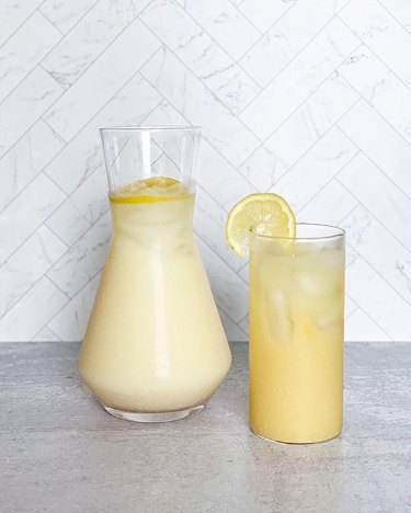 creamy lemonade in pitcher and glass