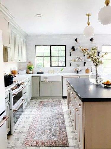 Kitchen with porcelain floor tile by Juniper Home
