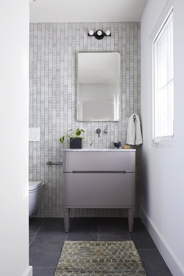 Glam bathroom with minimal light fixture designed by Black Lacquer Design
