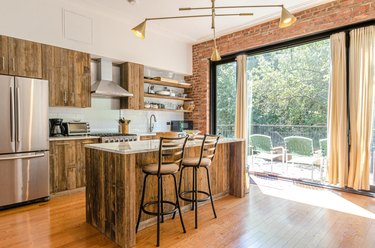 rustic kitchen wood cabinets floor to ceiling windows