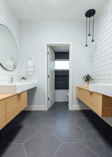 Minimal white bathroom design by Michelle Lisac