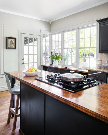 rustic kitchen black cabinets with wood countertop