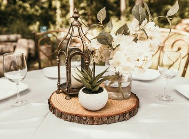 table with wood slice with decor