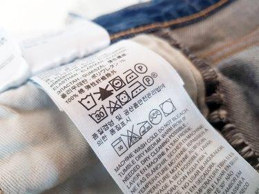 clothing tag with laundry symbols