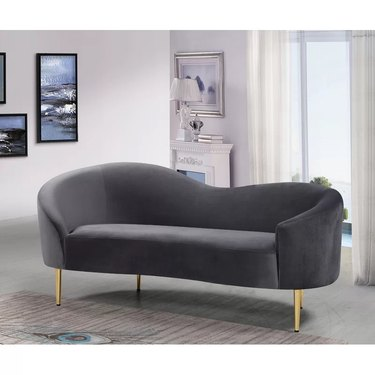 Grey curved loveseat