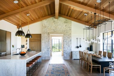 rustic kitchen with a stone wall