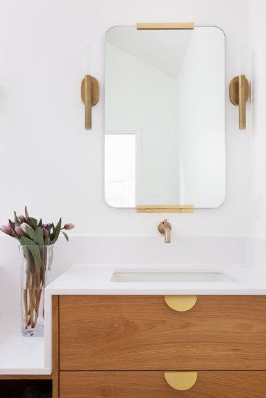 Minimal white bathroom designed by Shannon Eddings Interiors