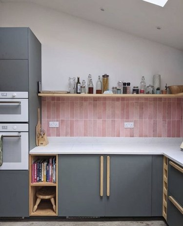 gray and white kitchen with pink backsplash