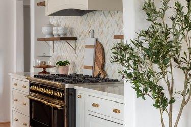 Chevron kitchen backsplash by Curated Nest Interiors