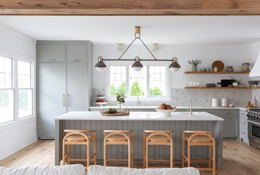 gray and white kitchen with white countertops