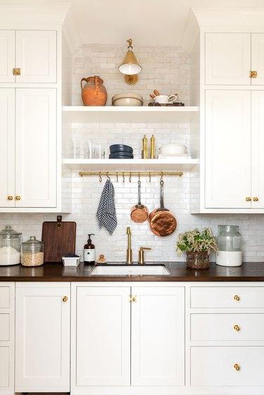Farmhouse style pantry with white backsplash by Studio McGee