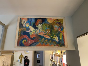 Leyden Lewis home with painting hung on wall