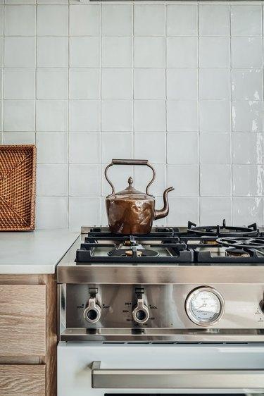 Farmhouse kitchen with square white tile backsplash