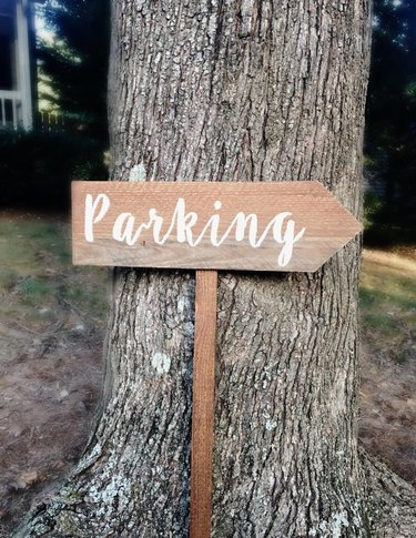 parking sign against tree